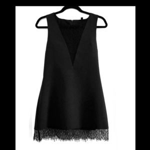 Little black dress with lace inserts and trim